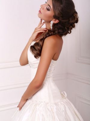 beautiful elegant bride with dark hair in wedding dress