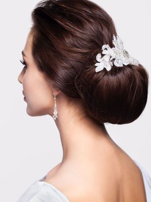 Portrait of beautiful young brunette woman from back side with knot of hair